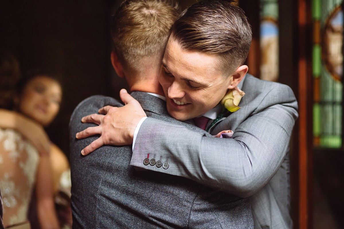 Groom and Brother Wedding Hug