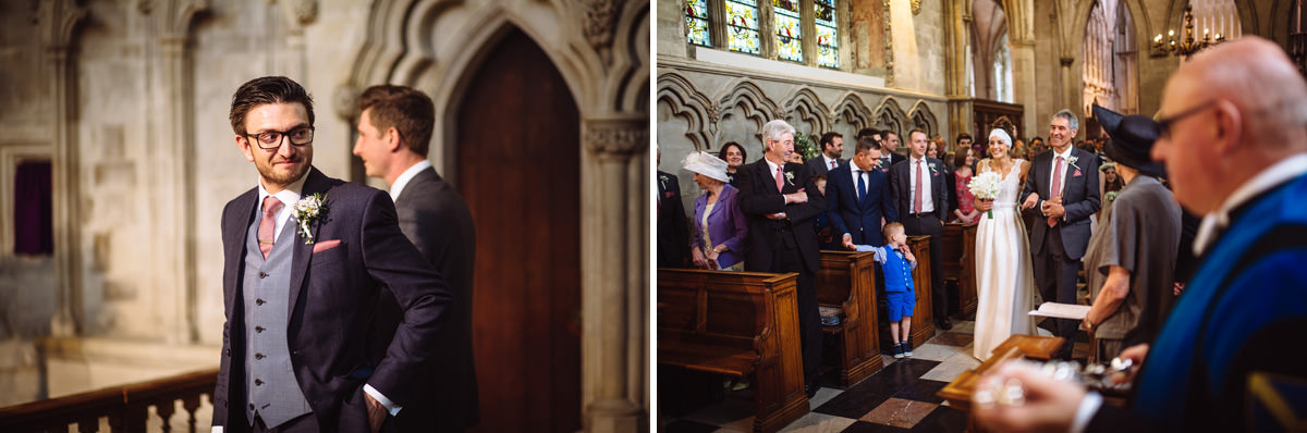 st albans cathedral bride and brides father walk arm in arm down the aisle