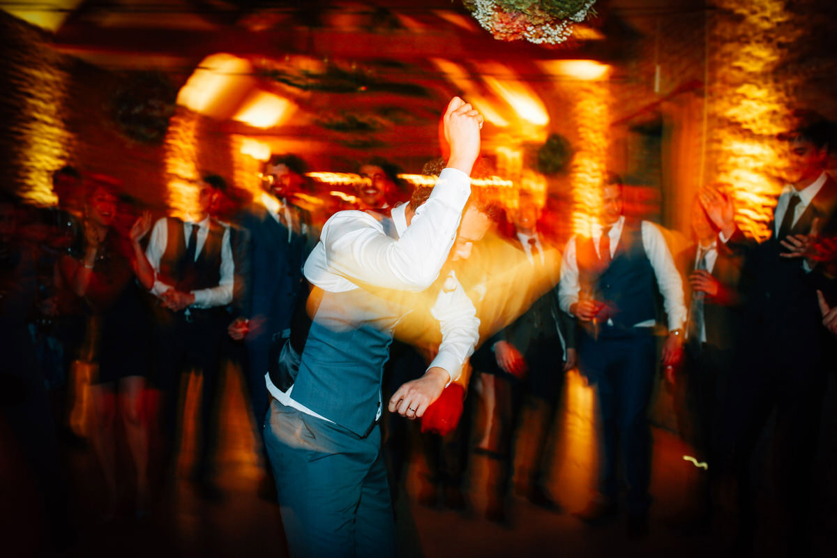 groom wedding dance photographs